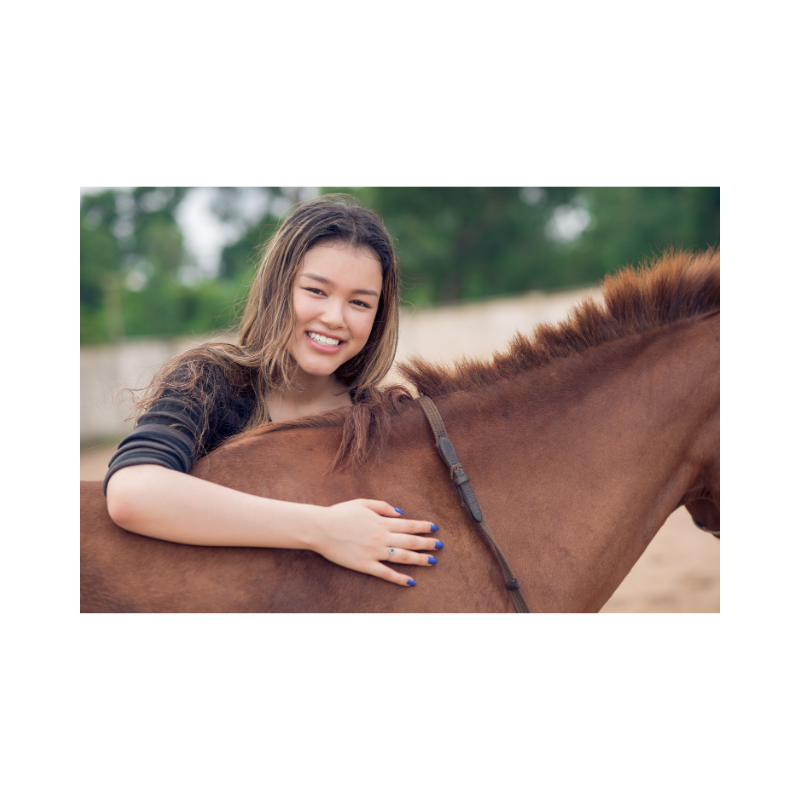 person with horse smiling